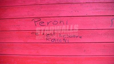 Scritte sui Muri italiani romeni una faccia una birra ..