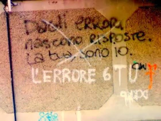 Scritte sui Muri Errare è umano